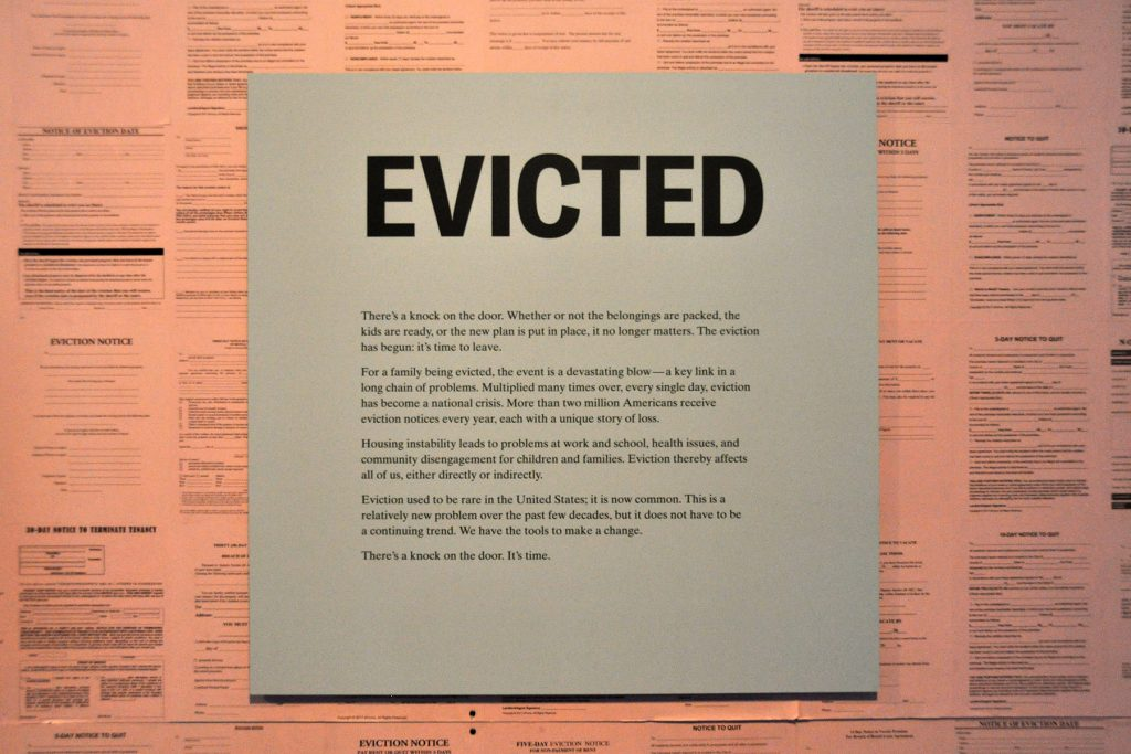 Eviction notices welcome visitors to an exhibition at the National Building Museum   © Deane Madsen
