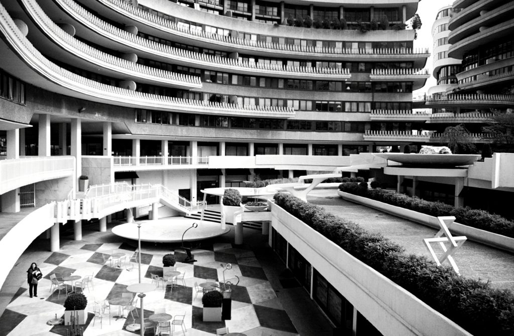 A lone pedestrian walks the lower level of the Watergate | © Deane Madsen